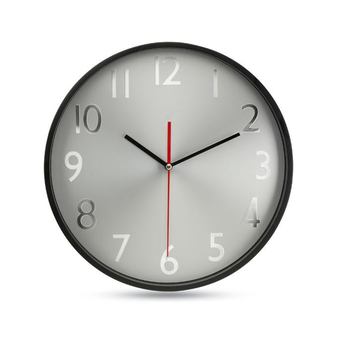 Ρολόι τοίχου με ασημί φόντο.